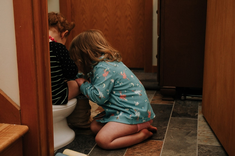 Seattle Family Documentary Photography, sibling helping younger on to use the potty
