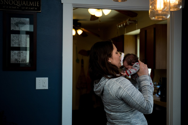 Seattle Family Documentary Photography, mother holding up baby