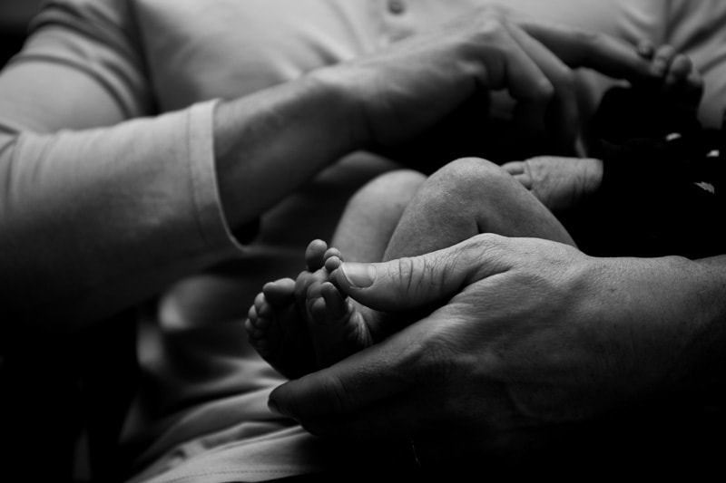Seattle Family Documentary Photography, dad playing with baby's hand