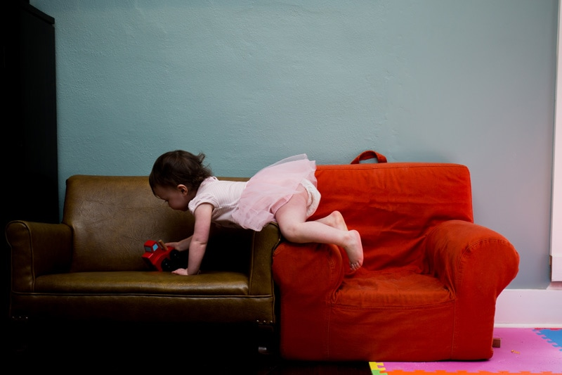Seattle Family Documentary Photography, girl crawling across chairs