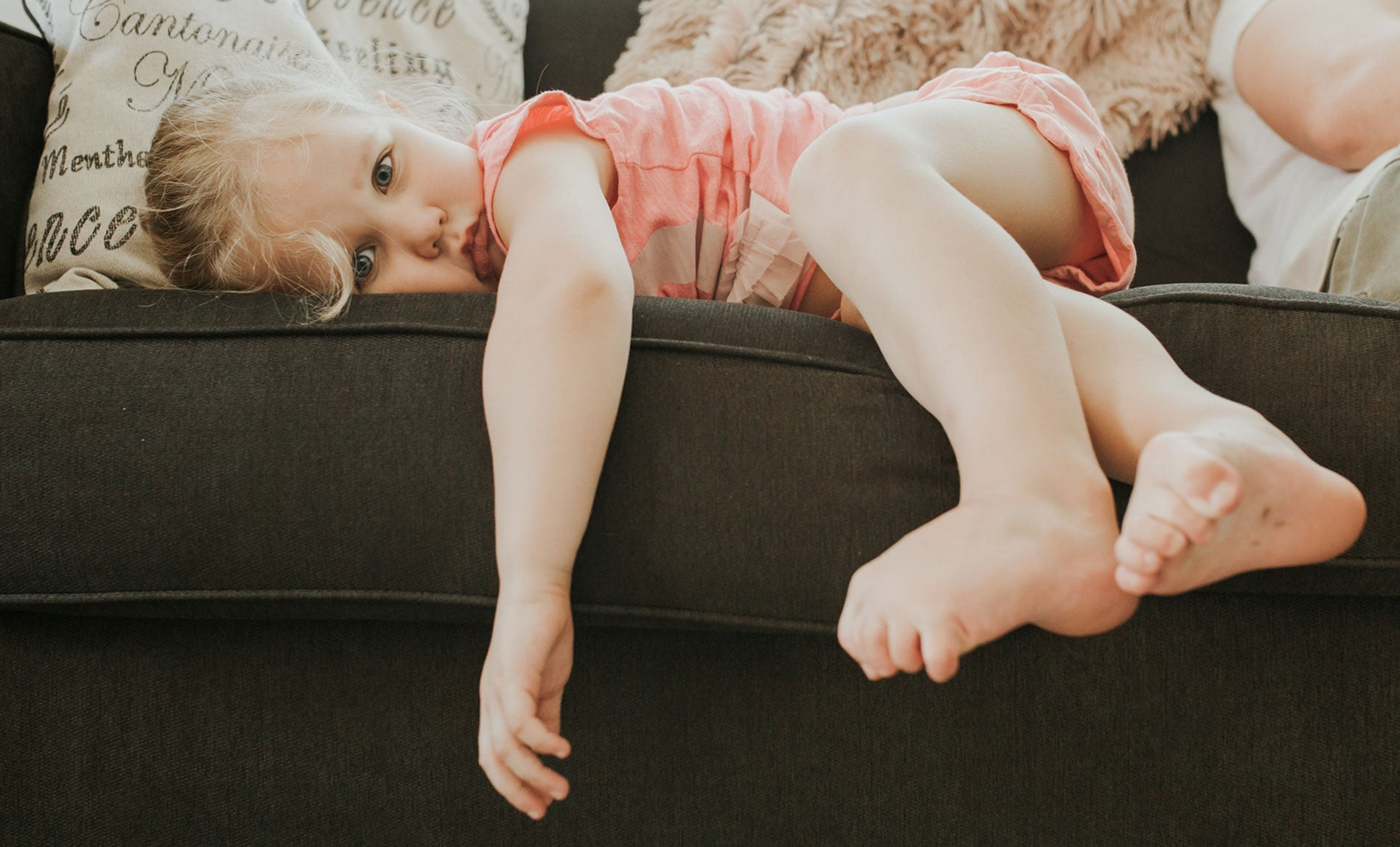 Family Documentary Photography, girl laying across the couch