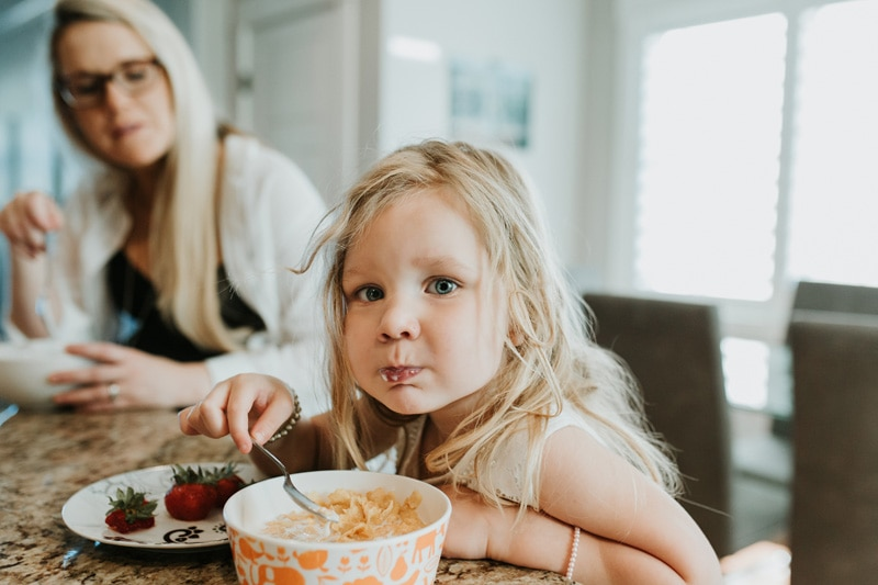Family Documentary Photography, girl eating breakfast with her mom