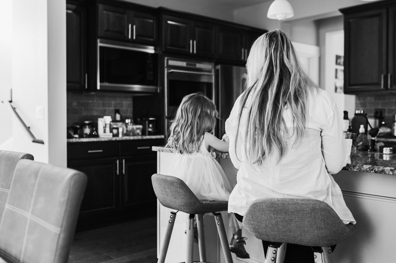 Seattle Family Documentary Photography, black and white of mother and daughter in the kitchen