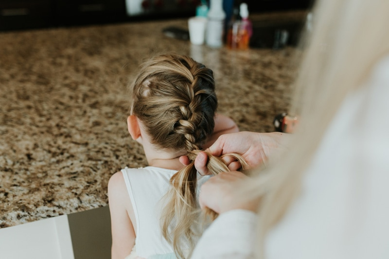 Seattle Family Documentary Photography, close up of mother braiding daugther's hair