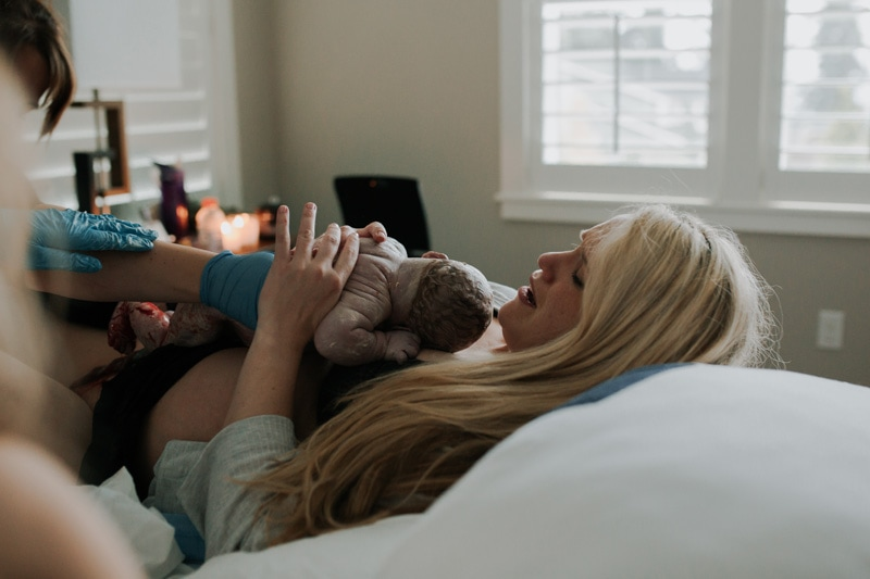 Seattle Birth Photography, mother getting her baby for the first time