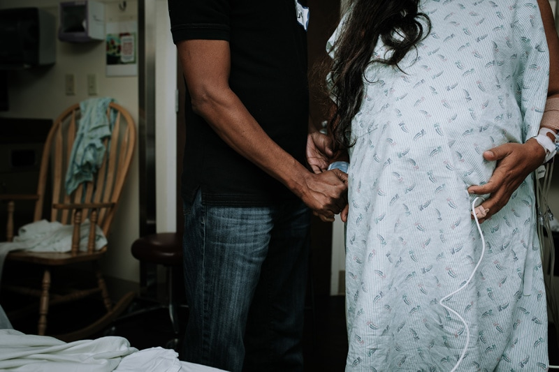 Seattle Birth Photography, husband helping wife into bed