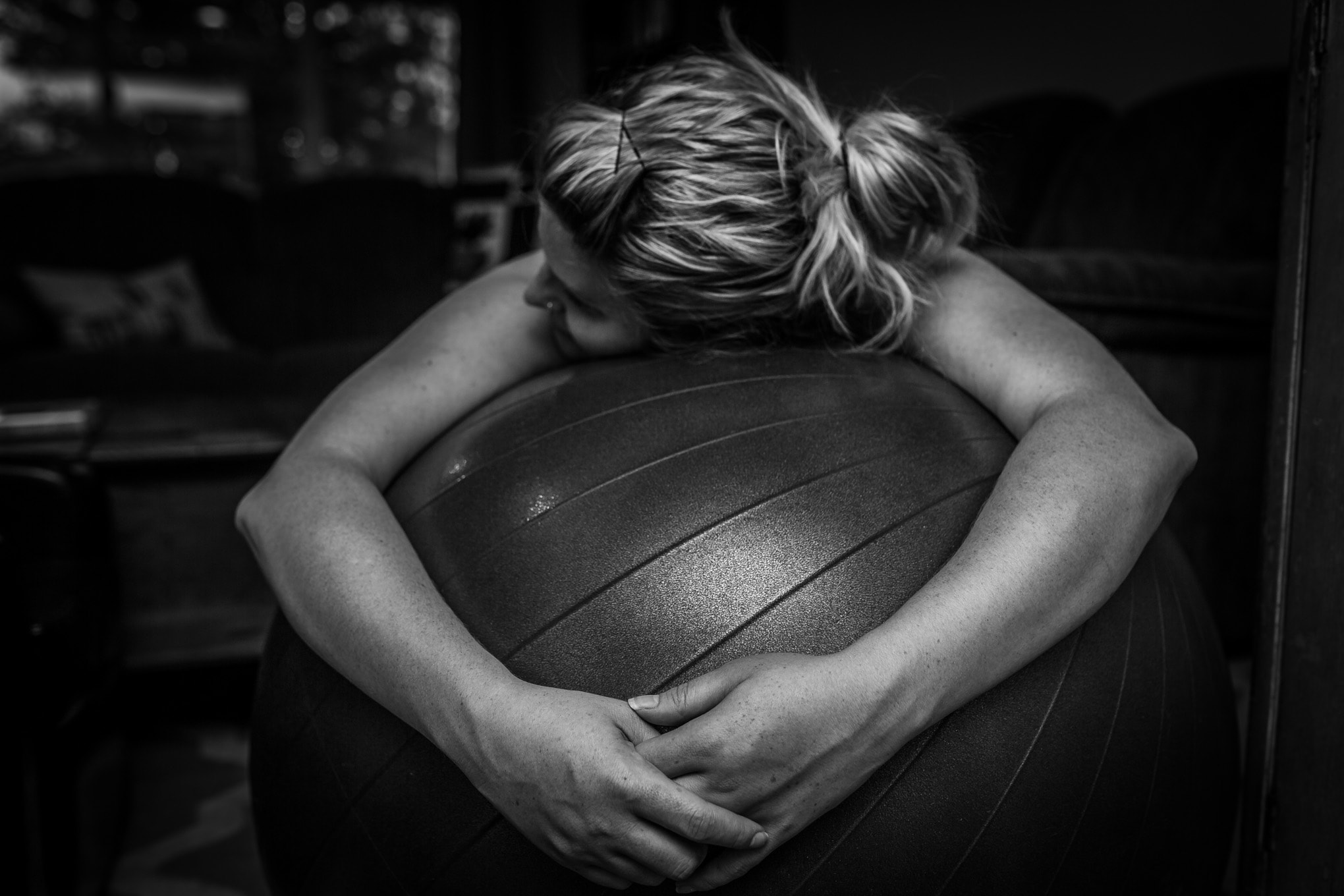 Denver Birth Photography, black and white of mother laboring on a ball