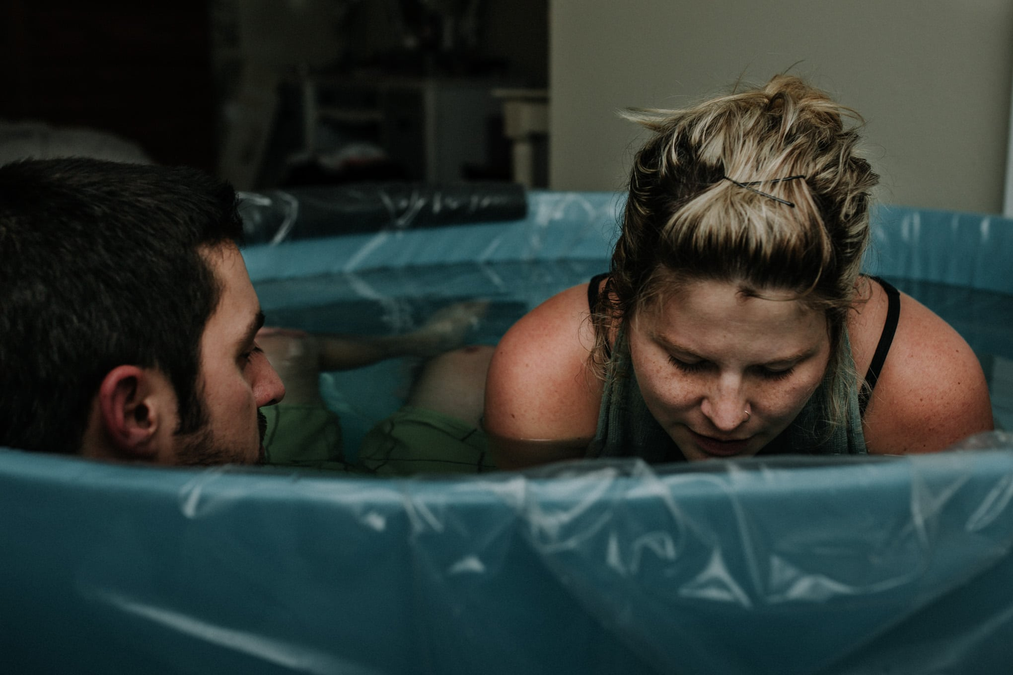Denver Birth Photography, mother laboring in tub with husband